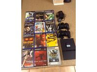 Playstation 2 slim with 2 controllers & 12 games.