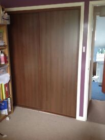 Walnut coloured sliding wardrobe doors