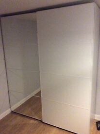 Huge floor to ceiling double wardrobe with mirrored door