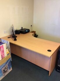 Large curved office desk.