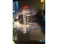 BRAND NEW SEALED 500gb PLAYSTATION 4 bundled with unchartered game PS4