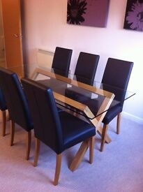 Glass and oak dining room table and 6 leather and oak matching chairs, immaculate condition.