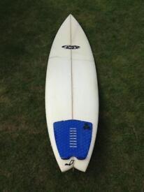 Creased Fluid juice surfboard
