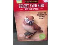 NEW bird solar light wall ornament with light up eyes
