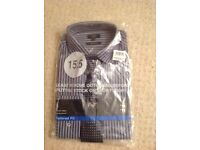 Tesco shirt and tie sets.