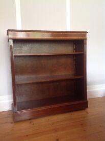 Reproduction bookshelf adjustable shelves on caster wheels.