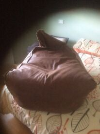Brown leather large bean bag never been used paid 70 pound want 30 pound