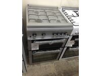 Beko silver 60cm gas cooker with glass lid. £339. New/graded 12 month Gtee