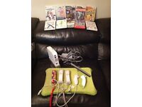 Wii console, wii fit, controllers, nunchucks and games bundle