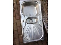 Stainless steel kitchen sink by France with mid drainer