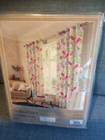 "Eyelet Curtains. Dunelm Clarissa Floral. Size 66"" x 72"". New."