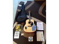 Encore Acoustic Guitar with bag, wall mount, electronic clip tuner and beginner documents