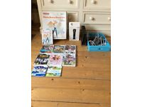 Wii console with 2 motion plus controllers and games