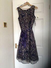 Designer label party dress. Blue , embossed.