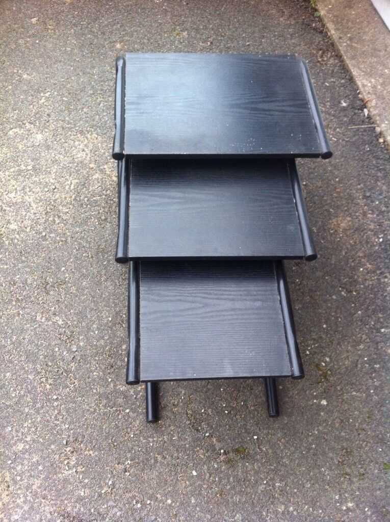 Delivery available. Nest of 3 tables in Black in good condition