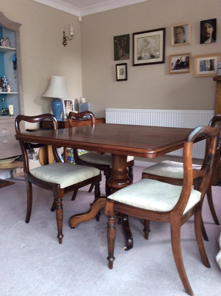 Mahogany table and 4 rosewood chairs