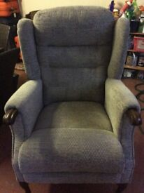 Almost new fully upholstered armchair in grey/green