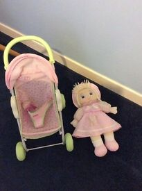 Dolls pram and doll