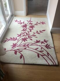 Wool pile rug 180 by 120cms