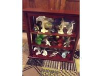 Dolphin ornaments and display cabinet