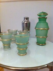 1930's green frosted glass decanter and 4 cocktail glasses, gold trim. cocktail table.