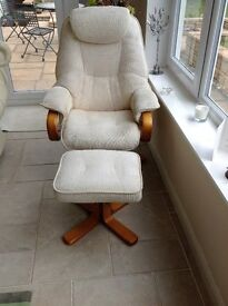 Reclining swivel chair with matching footstool.