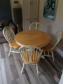 Extending Dining table and 4 chairs. Solid wood and cream paint. Excellent condition