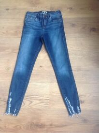 Ladies River Island size 10 Skinny Chewed Hem Jeans.
