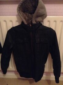 Boys black leather look NEXT jacket (Age 8) with grey fleece removable hood.
