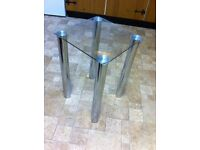 2 brand new small glass tables