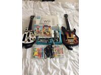 Nintendo Wii Guitar Hero Bundle inc guitar and microphone.
