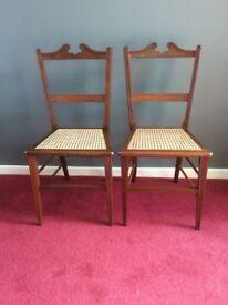 A fine pair of inlaid Georgian chairs.