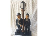 Laurel & Hardy leaning on lamppost