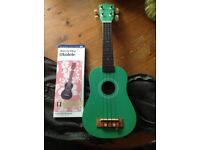 Ukulele, with instruction manual as well as case