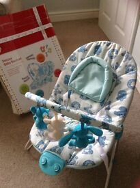 Deluxe vibrating baby bouncer with music