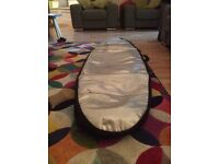 Surfboard. 6 ft glass Bunty excellent condition. With cover.