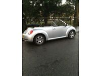 VW Beetle Luna convertible (57 Plate facelift model) in metallic Reflex Silver with black roof.