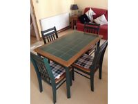 Dining table and 4 chairs plus cushions