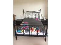 Beautiful curved black double bed frame with optional mattress and topper