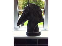 Metal horse ornament .
