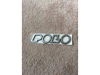 New VW POLO badge in wrapper - plastic silver/Black