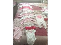 Baby girl bundle of clothes and Moses basket and stand