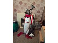 Wilson golf clubs with bag and trolley.Very good condition hardly used.