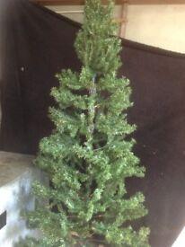 8 ft slim green Christmas tree