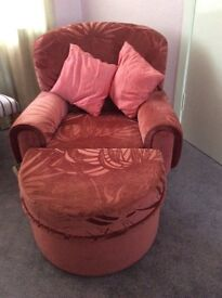 Pink chair with matching pouffe
