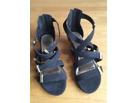 Brand New and Unworn Ladies Black and Gold Gladiator Sandals (UK 6 / EU 39)