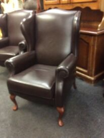 Brown wing back chair