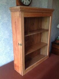 Antique pine glass fronted bookcase