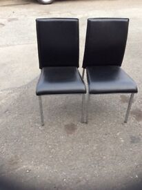 2 black dinning chairs
