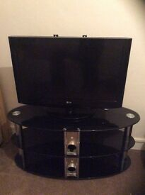 Lg 32inch tv (used but in good condition) with tv stand